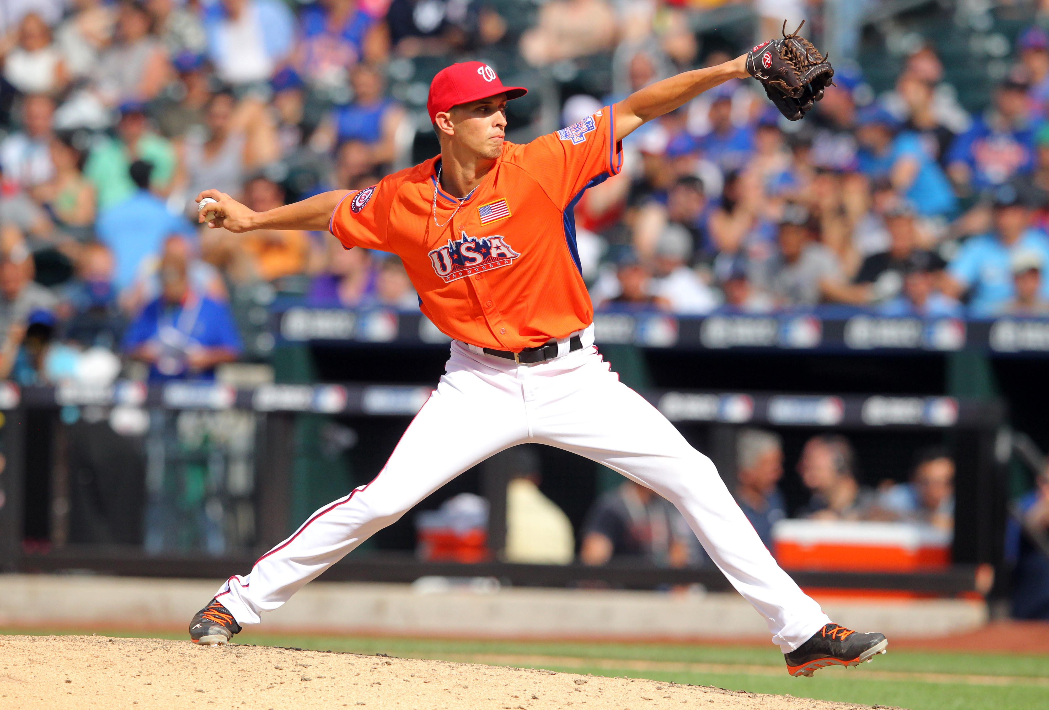 Jul 14, 2013; Flushing , NY, USA; USA pitcher A.J. Cole throws a pitch during the 2013 All Star Futures Game at Citi Field. USA defeated World 4-2. Mandatory Credit: Brad Penner-USA TODAY Sports